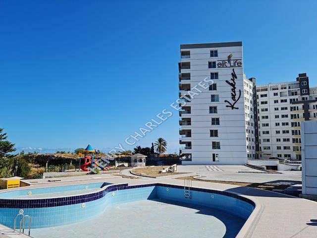 Girne Girne Bölgesi'de satılık asansörlü havuzlu daire - TEXT_photo 2